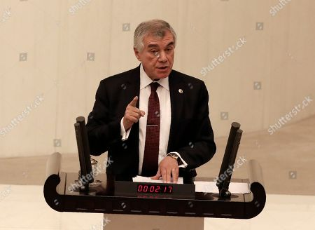 Unal Cevikoz, a lawmaker of the main opposition Republican People's Party, speaks before Turkey's parliament authorized the deployment of troops to Libya to support the U.N.-backed government in Tripoli battle forces loyal to a rival government that is seeking to capture the capital, in Ankara, Turkey, . Turkish lawmakers voted 325-184 at an emergency session in favor of a one-year mandate allowing the government to dispatch troops amid concerns that Turkish forces could aggravate the conflict in Libya and destabilize the region