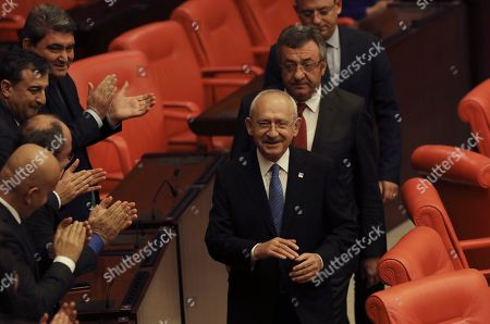 Kemal Kilicdaroglu, the leader of the main opposition Republican People's Party, arrives before Turkey's parliament authorized the deployment of troops to Libya to support the U.N.-backed government in Tripoli battle forces loyal to a rival government that is seeking to capture the capital, in Ankara, Turkey, . Turkish lawmakers voted 325-184 at an emergency session in favor of a one-year mandate allowing the government to dispatch troops amid concerns that Turkish forces could aggravate the conflict in Libya and destabilize the region