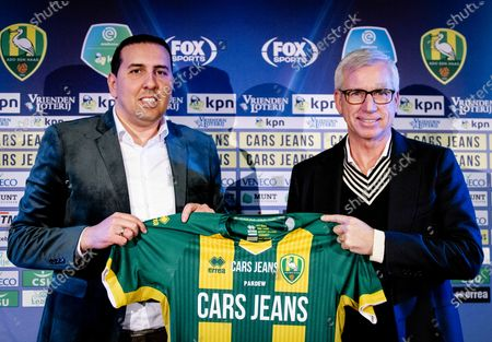ADO Den Hague's new head coach Alan Pardew (R) poses with the club's General manager Mohammed Hamdi (L) during his presentation at the Cars Jeans Stadium in The Hague, The Netherlands, 02 January 2020.