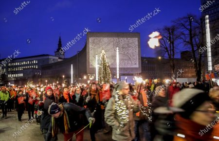 Stock Photo of People attend a protest against the demolition of a former government Y-Blokka building in the government quarter in Oslo, Norway, 02 January 2020. The Y-Blokka building was one of Norway's government buildings until 22 July 2011 when far-right terrorist Anders Breivik, placed a car bomb near the building killing eight people.