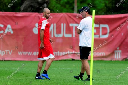 Argentinian soccer player Javier Mascherano (L) talks with the coach of Estudiantes de La Plata, Gabriel Milito (R), during the start of the preseason, at the City Bell Country Club of the city of La Plata, province of Buenos Aires, Argentina, 02 January 2020.