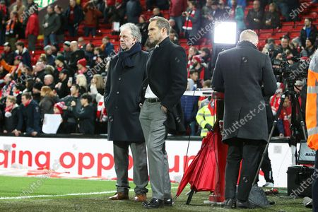 Liverpool legends Mark Lawrenson and Jason Macateer watch the players warming up during the Premier League match between Liverpool and Sheffield United at Anfield, Liverpool