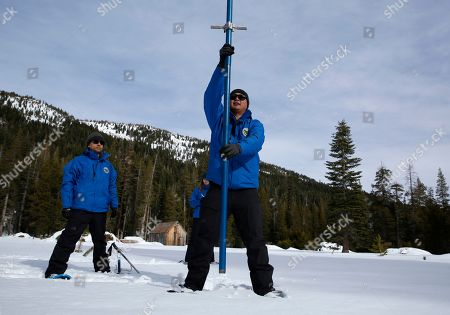 Stock Picture of Ramesh Gautam, Sean de Guzman, Lauren Miller. Sean de Guzman, right, chief of snow surveys for the California Department of Water Resources, plunges a snow survey tube into the snowpack during the first snow survey of the season at Phillips Station near Echo Summit, Calif., . The survey found the snowpack at 33.5 inches deep with a water content of 11 inches which is 97% of average at this location at this time of year. Also seen are DWR's Ramesh Gautam, left, and Lauren Miller, behind de Guzman