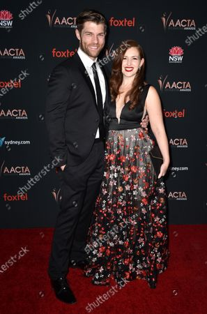 Stock Photo of Liam McIntyre and Erin Hasan