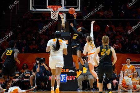 Nadia Green #10 of the Missouri Tigers shoots the ball over Lou Brown #21 of the Tennessee Lady Vols during the NCAA basketball game between the University of Tennessee Lady Volunteers and University of Missouri Tigers at Thompson Boling Arena in Knoxville TN Tim Gangloff/CSM