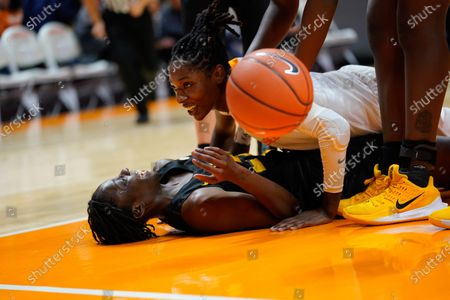Stock Photo of Rennia Davis #0 of the Tennessee Lady Vols lands on Amber Smith #23 of the Missouri Tigers after fouling her during the NCAA basketball game between the University of Tennessee Lady Volunteers and University of Missouri Tigers at Thompson Boling Arena in Knoxville TN Tim Gangloff/CSM
