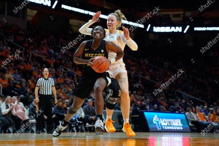 Amber Smith #23 of the Missouri Tigers drives to the basket against Lou Brown #21 of the Tennessee Lady Vols during the NCAA basketball game between the University of Tennessee Lady Volunteers and University of Missouri Tigers at Thompson Boling Arena in Knoxville TN Tim Gangloff/CSM