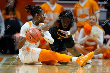 Amber Smith #23 of the Missouri Tigers reaches for the ball held by Rennia Davis #0 of the Tennessee Lady Vols during the NCAA basketball game between the University of Tennessee Lady Volunteers and University of Missouri Tigers at Thompson Boling Arena in Knoxville TN Tim Gangloff/CSM