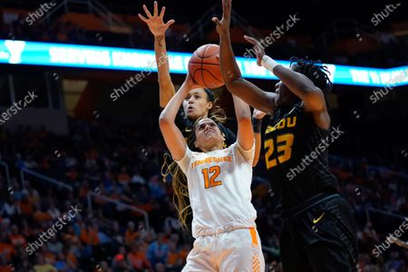 Rae Burrell #12 of the Tennessee Lady Vols shoots the ball over Amber Smith #23 of the Missouri Tigers during the NCAA basketball game between the University of Tennessee Lady Volunteers and University of Missouri Tigers at Thompson Boling Arena in Knoxville TN Tim Gangloff/CSM