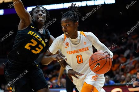 Stock Picture of Rennia Davis #0 of the Tennessee Lady Vols drives to the basket against Amber Smith #23 of the Missouri Tigers during the NCAA basketball game between the University of Tennessee Lady Volunteers and University of Missouri Tigers at Thompson Boling Arena in Knoxville TN Tim Gangloff/CSM