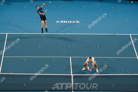 Jamie Murray and Joe Salisbury of Britain serve in the game against Grigor Dimitrov and Alexander Lazarov of Bulgaria during their ATP Cup tennis match in Sydney