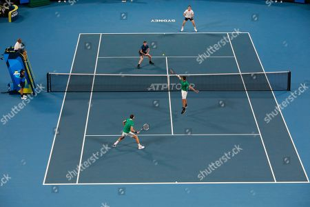 Jamie Murray and Joe Salisbury of Britain, top, in action against Grigor Dimitrov and Alexander Lazarov of Bulgaria during their ATP Cup tennis match in Sydney, Australia