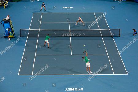 Grigor Dimitrov, Alexander Lazarov. Jamie Murray and Joe Salisbury of Britain, top, in action against Grigor Dimitrov and Alexander Lazarov of Bulgaria during their ATP Cup tennis match in Sydney, Australia