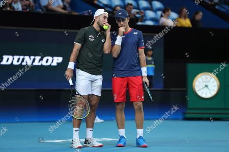 Viktor Durasovic, Casper Ruud. Norway's Viktor Durasovic, left, and Casper Ruud talk during their doubles match against Rajeev Ram and Austin Krajicek of the United States during their match at the ATP Cup in Perth, Australia