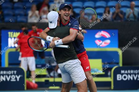 Viktor Durasovic, Casper Ruud. Norway's Viktor Durasovic, left, and Casper Ruud celebrate winning their doubles match against Rajeev Ram and Austin Krajicek of the United States during their match at the ATP Cup in Perth, Australia