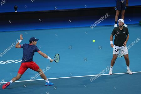 Viktor Durasovic, Casper Ruud. Norway's Viktor Durasovic, right, and Casper Ruud in their doubles match against Rajeev Ram and Austin Krajicek of the United States during their match at the ATP Cup in Perth, Australia