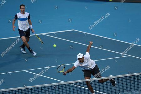 Austin Krajicek, Rajeev Ram. Austin Krajicek, left, and Rajeev Ram of the United States during their doubles match against Norway's Viktor Durasovic and Casper Ruud at the ATP Cup in Perth, Australia