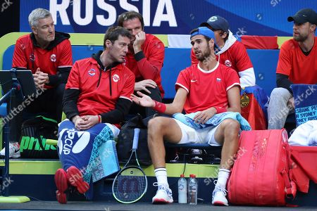 Russia's Karen Kachanov, right, talks to Russian Captain Marat Safin during a points break against Stefano Travaglia of Italy during their match at the ATP Cup in Perth, Australia
