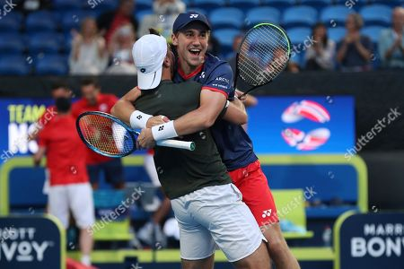 Viktor Durasovic, Casper Ruud. Norway's Viktor Durasovi, left, and Casper Ruud celebrate winning their doubles match against Rajeev Ram and Austin Krajicek of the United States during their match at the ATP Cup in Perth, Australia