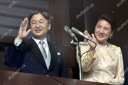 Stock Picture of For the first time as Japans monarch, Emperor Naruhito waves to a huge throng of flag-waving well-wishers from the Imperial Palace balcony in his first New Years greeting since ascending to the throne. Naruhito and his wife Empress Masako were joined by his parents, the Former Emperor Akihito and his wife Michiko, his younger brother Prince Akishino, his wife Kiko, and their two daughters Mako and Kako.