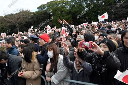 A huge throng of flag-waving well-wishers cheers as Japans Emperor Naruhito appears on the Imperial Palace balcony, in his first New Years greeting since ascending to the throne. Naruhito and his wife Empress Masako were joined by his parents, the Former Emperor Akihito and his wife Michiko, his younger brother Prince Akishino, his wife Kiko, and their two daughters Mako and Kako.