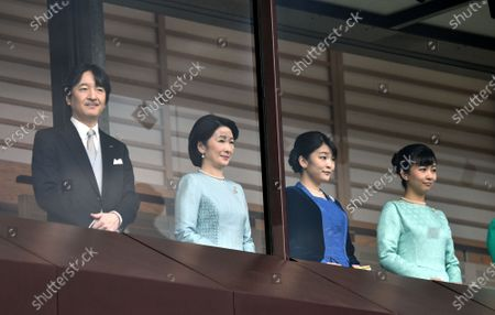 Prince Akishino, the younger brother of Japans Emperor Naruhito, his wife Kiko, and their two daughters Mako and Kako, from left, appear on the Imperial Palace balcony, greeting a huge throng of flag-waving well-wishers during a New Years general audience in Tokyo on Thursday, January 2, 2020.