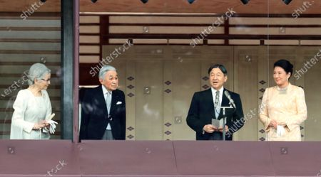 Stock Image of Japanese Emperor Naruhito (2nd R) delivers a speech while Empress Masako (R), Former Emperor Akihito (2nd L) and Former Empress Michiko look on for the New Year's greetings at the Imperial Palace