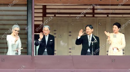 Former Empress Michiko, Former Emperor Akihito, Emperor Naruhito and Empress Masako wave to wellwishers for the New Year's greetings at the Imperial Palace