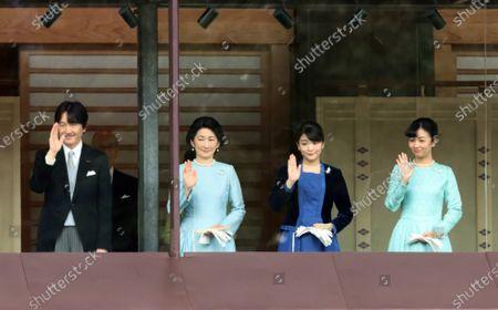 (L-R) Crown Prince Akishino, Crown Princess Akishino, Princess Mako and Princess Kako wave to wellwishers for the New Year's greetings at the Imperial Palace