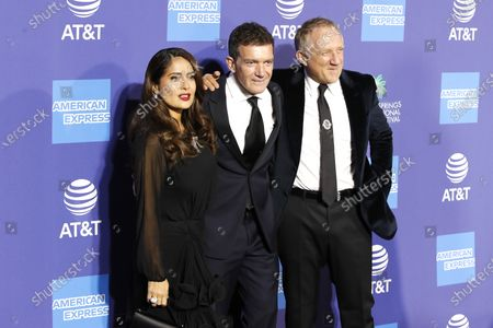 Salma Hayek (L), Spanish actor Antonio Banderas (C) and French businessman Francois-Henri Pinault (R) arrive at the 31st Palm Springs International Film Festival in Palm Springs, California, USA, 02 January 2020. The Palm Springs International Film Festival awards actors in eleven categories.