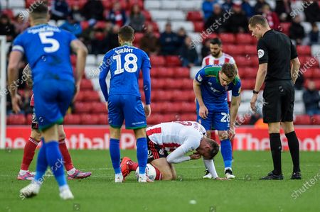 Stock Picture of 4th January 2020, Stadium Of Light, Sunderland, England; Sky Bet League 1, Sunderland v Lincoln City : Charlie Wyke (9) of Sunderland is injured after a blow to the face