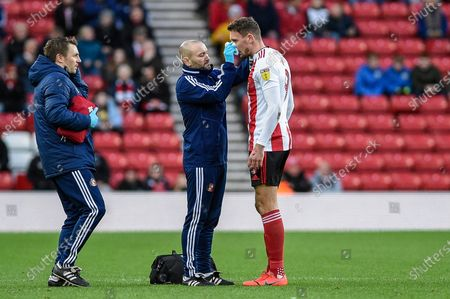 4th January 2020, Stadium Of Light, Sunderland, England; Sky Bet League 1, Sunderland v Lincoln City : Charlie Wyke (9) of Sunderland is injured after a blow to the face