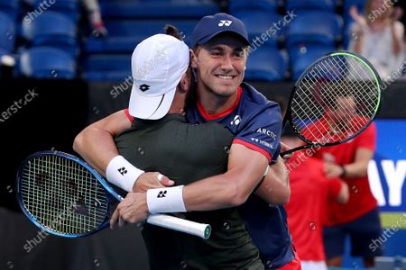 Casper Ruud (right) and Viktor Durasovic of Norway celebrate after winning their doubles match against Austin Krajicek and Rajeev Ram of the USA during day 1 of the ATP Cup tennis tournament at RAC Arena in Perth, Australia, 03 January 2020.