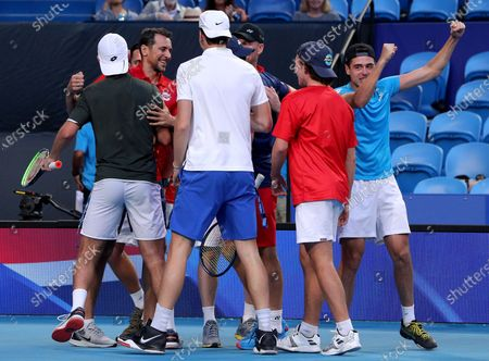 Team Norway celebrate after Casper Ruud and Viktor Durasovic of Norway win their doubles match against Austin Krajicek and Rajeev Ram of the USA during day 1 of the ATP Cup tennis tournament at RAC Arena in Perth, Australia, 03 January 2020.