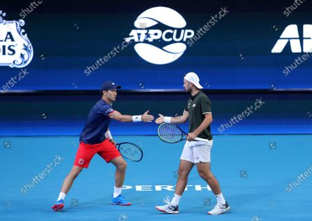 Casper Ruud and Viktor Durasovic of Norway in action during their doubles match against Austin Krajicek and Rajeev Ram of the USA during day 1 of the ATP Cup tennis tournament at RAC Arena in Perth, Australia, 03 January 2020.