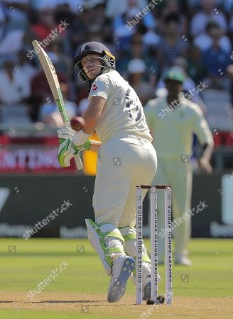 England's batsman Jos Buttler watches as the ball flies down to the boundary during day one of the second cricket test between South Africa and England at the Newlands Cricket Stadium in Cape Town, South Africa