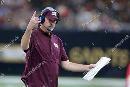 Mississippi State head coach Joe Moorhead gestures during the second half of their NCAA college football game against the Louisiana-Lafayette, in New Orleans. Two people with knowledge of the situation say Mississippi State has fired coach Joe Moorhead after just two seasons. They spoke to The Associated Press on condition of anonymity because an announcement had not yet been made by the school. A meeting was scheduled, with Moorhead and athletic director John Cohen