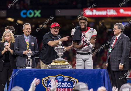 Georgia head coach Kirby Smart and Georgia wide receiver George Pickens (1) on the stage following NCAA Football game action between the Georgia Bulldogs and the Baylor Bears at Mercedes-Benz Superdome in New Orleans, Louisiana. Georgia defeated Baylor 26-14