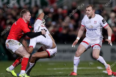 Ulster vs Munster. Ulster's Robert Baloucoune is tackled by Keith Earls of Munster