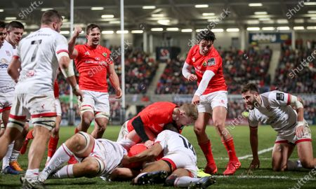 Ulster vs Munster. Munster's Arno Botha, Joey Carbery and Keith Earls celebrate Shane Daly scoring a try