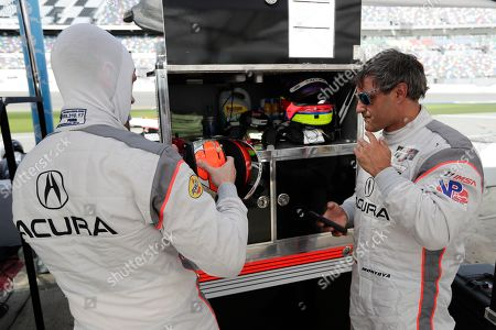 Dane Cameron, Juan Pablo Montoya. Dane Cameron, left, prepares to go out on the track after Juan Pablo Montoya, right, comes in for a break during testing for the upcoming Rolex 24 hour auto race at Daytona International Speedway, in Daytona Beach, Fla