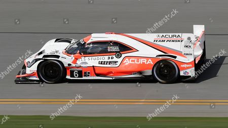 Stock Photo of Juan Pablo Montoya drives the Team Penske Acura Dpi through the front stench during testing for the upcoming Rolex 24 hour auto race at Daytona International Speedway, in Daytona Beach, Fla