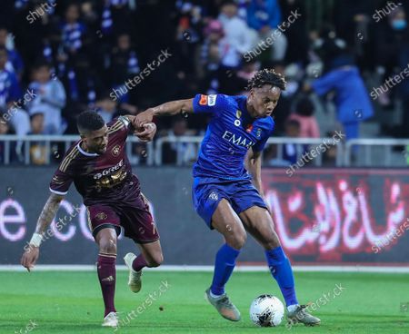 Al-Hilal's Andre Carrillo (R) in action against Al-Faisaly's Roly Bonevacia (L) during the Saudi King's Cup Round of 16 match between Al-Hilal and Al-Faisaly at King Salman Sport City Stadium, Majmaah, Saudi Arabia, 03 January 2020.
