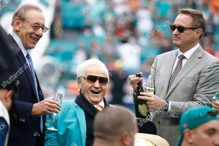 Don Shula, Stephen Ross, Tom Garfinkle. Miami Dolphins owner Stephen Ross, left, toasts former head coach Don Shula, center, during a half time celebration of the 1972 undefeated Dolphins team during an NFL football game against the Cincinnati Bengals, in Miami Gardens, Fla. At right is Dolphins CEO Tom Garfinkel. Shula will turn 90 on
