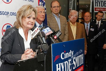 Cindy Hyde-Smith, Roger Wicker, Delbert Hosemann, Haley Barbour. U.S. Sen. Cindy Hyde-Smith, R-Miss., left, thanks fellow Republican U.S. Sen. Roger Wicker, of Mississippi, second from left, Lt. Gov.-elect Delbert Hosemann, center, and former Mississippi Republican Gov. Haley Barbour, for supporting her bid for re-election, at state GOP headquarters in Jackson, Miss. Hyde-Smith filed papers to run at party headquarters, with many Republican elected officials in attendance. She is expected to campaign by emphasizing her loyalty to President Donald Trump