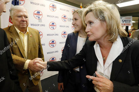 Stock Image of Cindy Hyde-Smith, Haley Barbour, Anna-Michael Smith. U.S. Sen. Cindy Hyde-Smith, R-Miss., right, thanks former Mississippi Republican Gov. Haley Barbour, left, for supporting her bid for re-election as her daughter Anna-Michael Smith, center, looks, at state GOP headquarters in Jackson, Miss. Hyde-Smith filed papers to run at party headquarters, with many Republican statewide elected officials in attendance. She is expected to campaign by emphasizing her loyalty to President Donald Trump