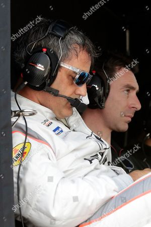 Stock Picture of Juan Pablo Montoya, left, and Simon Pagenaud watch teammate Dane Cameron on the track during testing for the upcoming Rolex 24 hour auto race at Daytona International Speedway, in Daytona Beach, Fla