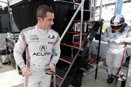 Stock Image of Dane Cameron, left, prepares to go out on the track after Juan Pablo Montoya, right, comes in for a break during testing for the upcoming Rolex 24 hour auto race at Daytona International Speedway, in Daytona Beach, Fla