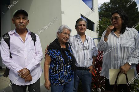 Stock Image of Mario Romero, Esperanza Ramos, Juan Jose Dalton and Irma Serrano after requesting before the Attorney General's Office to investigate the disappearance of a relative during the civil war, in San Salvador, El Salvador, 03 January 2020. The relatives of seven people missing during the civil war in El Salvador at the hands of the security forces and the guerrillas asked the Prosecutor's Office o investigate these crimes, allegations splashing the former guerrilla commander and former President of the country between 2014 and 2019, Salvador Sanchez Ceren.
