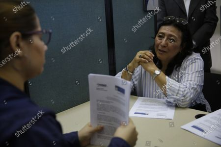 Irma Serrano (R) requests that her brother's disappearance in 1980 to be investigated, at the Attorney General's Office (FGR), in San Salvador, El Salvador, 03 January 2020. The relatives of seven people missing during the civil war in El Salvador at the hands of the security forces and the guerrillas asked the Prosecutor's Office o investigate these crimes, allegations splashing the former guerrilla commander and former President of the country between 2014 and 2019, Salvador Sanchez Ceren.